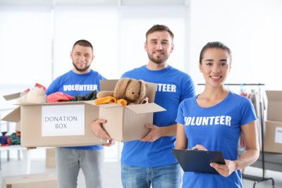 three volunteers smiling